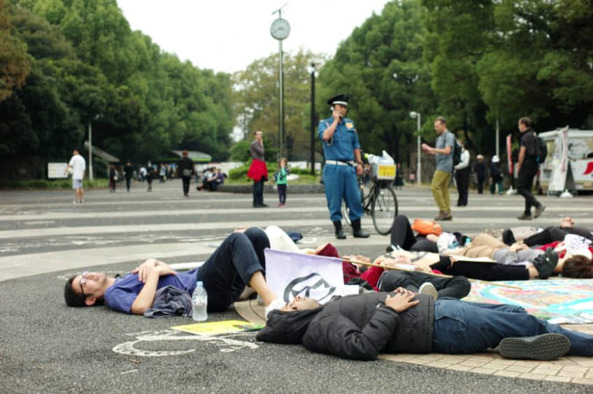 Extinction Rebellion climate protest arrives in Tokyo with 'die-in' at Yoyogi Park